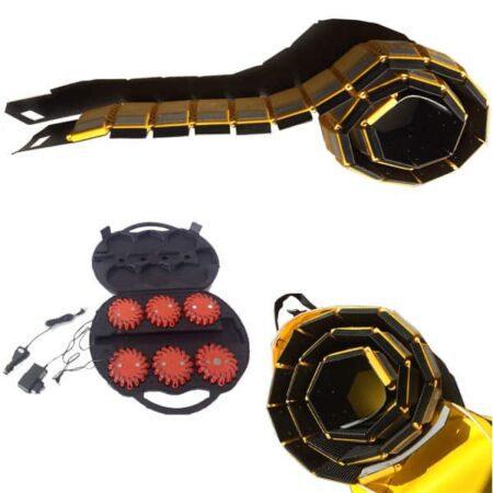 Bild av ormen farthinder och ljuspuck. Gul/svart farthinder med väska.